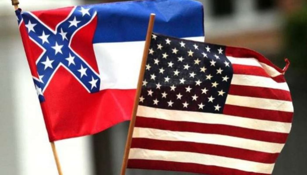 Mississippi governor signs bill removing confederate symbol from flag