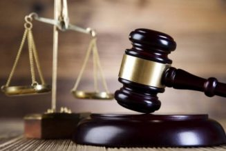 Trader in court for allegedly stealing colleague's cell phone