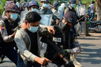 Myanmar police fire rubber bullets, wounding three, as hundreds of thousands protest