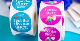 Vaccine centers embrace stickers and selfie stations