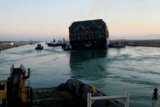 Suez Canal Authority says stranded ship partially refloated