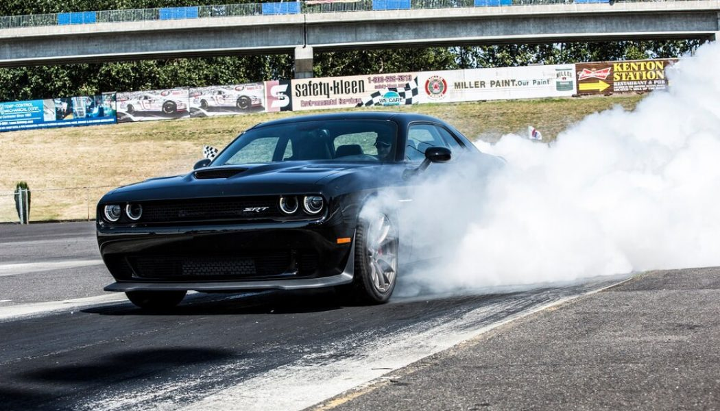 Dodge Challenger Hellcat Leaves Car Event, Immediately Tips Over Chevy Silverado